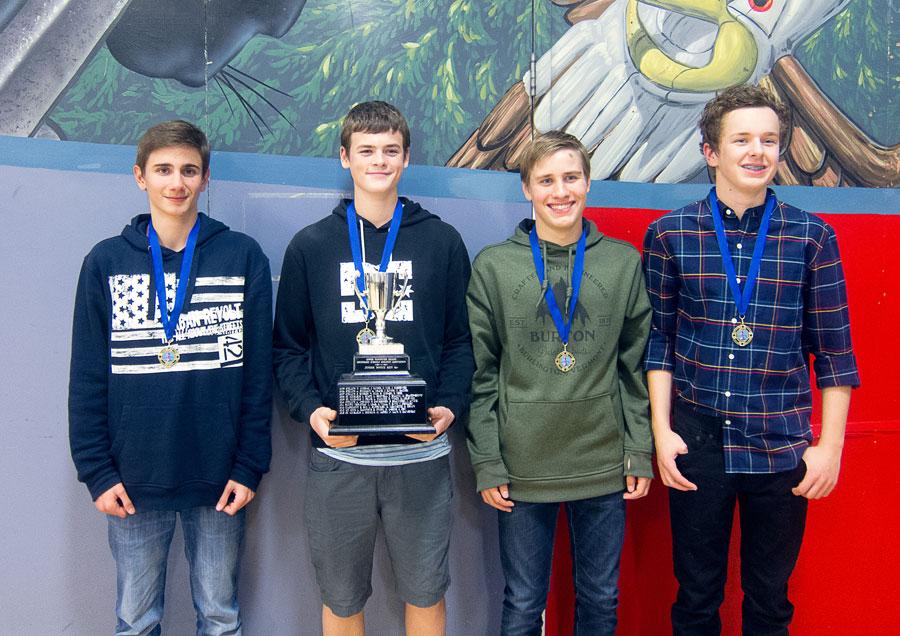 Boys receiving rowing awards