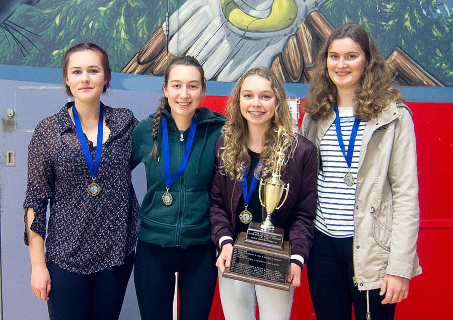 Girls receiving rowing awards