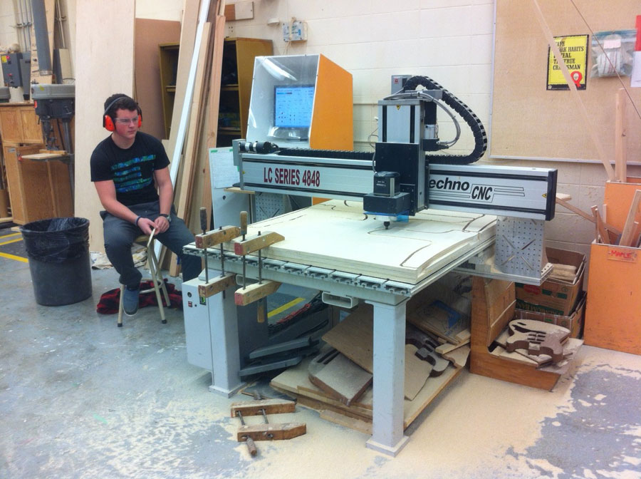 Thomas Bennett controls the Computer Numerical Controlled (CNC) router during Carpentry/Joinery 11/12 in block A