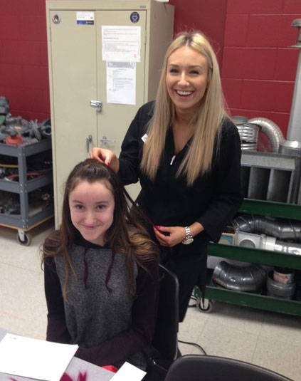 Madison Partridge styling hair in the Try a Trade Event at Skills Canada
