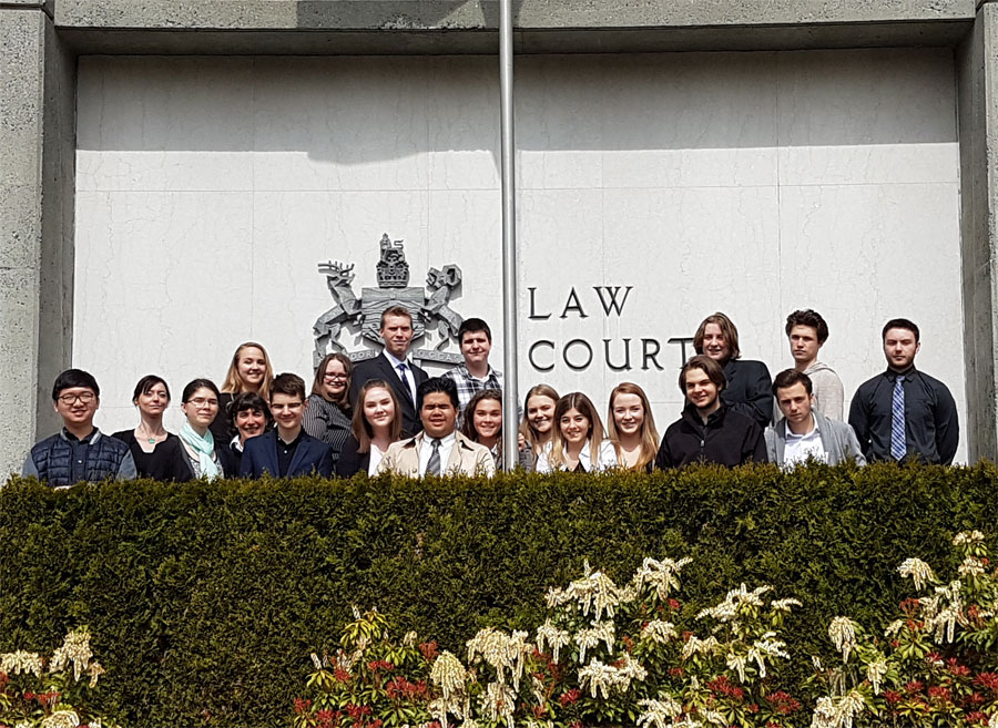 Parkland Law 12 class stands in front of the BC Law Courts