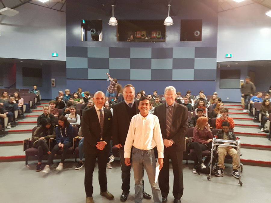 Parkland Student Paarth stands with Gary Molman (NDP), Adam Olsen (Green), and Stephen Roberts (Liberal) at an All Candidates debate