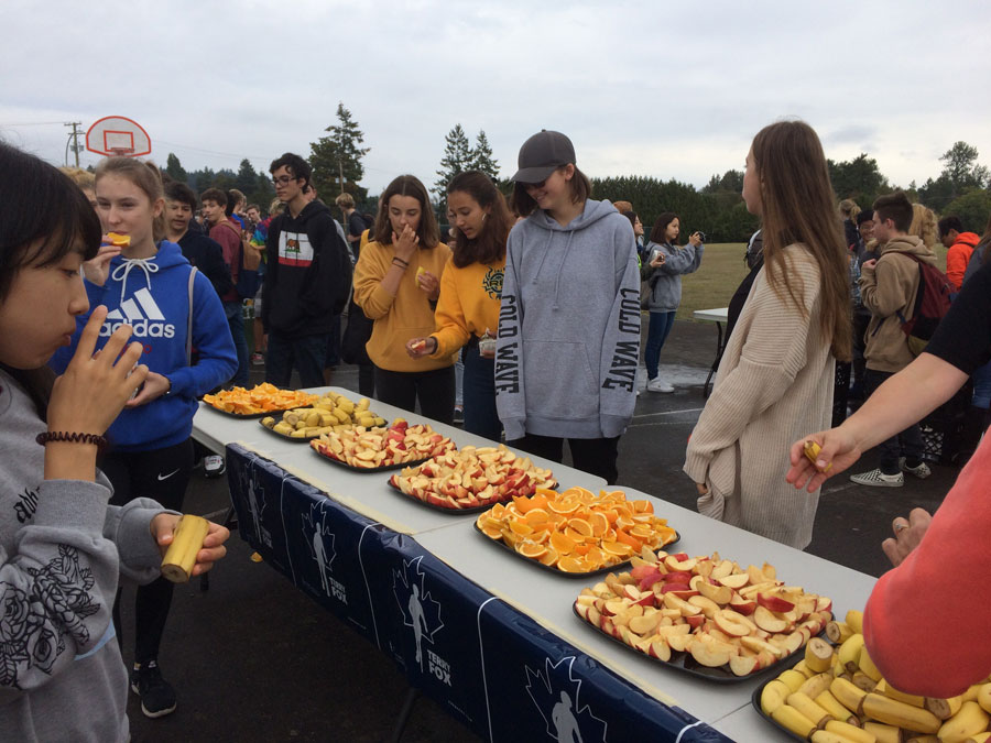 Students enjoy fresh fruit provided by the Sidney Thrifty Foods