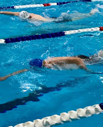 Erik competing in 100 I.M.