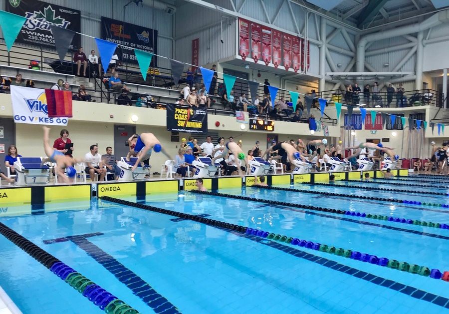 Taise, Nick, Brendon, and Filippo take off to start the 100 IM event.